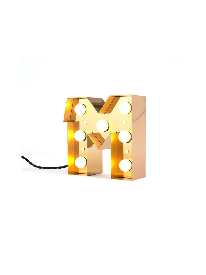 Caractère-valokirjain, M